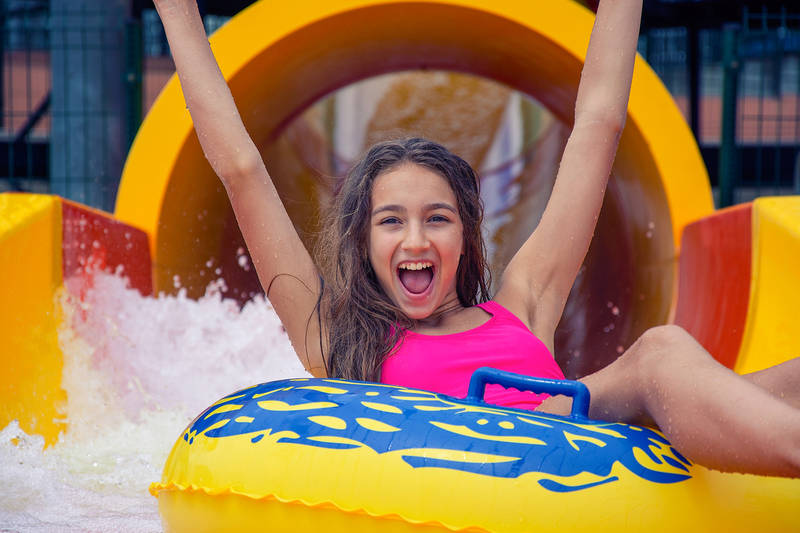 Kid-sliding-on-Water-Slide-at-Raging-Waters-San-Dimas-which-is-among-the-best-waterpark-in-the-United-States