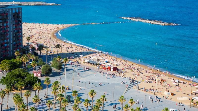 View-of-the-beach-in-Barcelona-with-crowds-of-people-on-the-sand