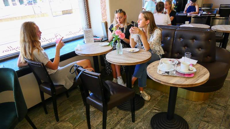 Group-of-friends-enjoying-coffee-in-a-cafe-in-Sweden-Fika-time