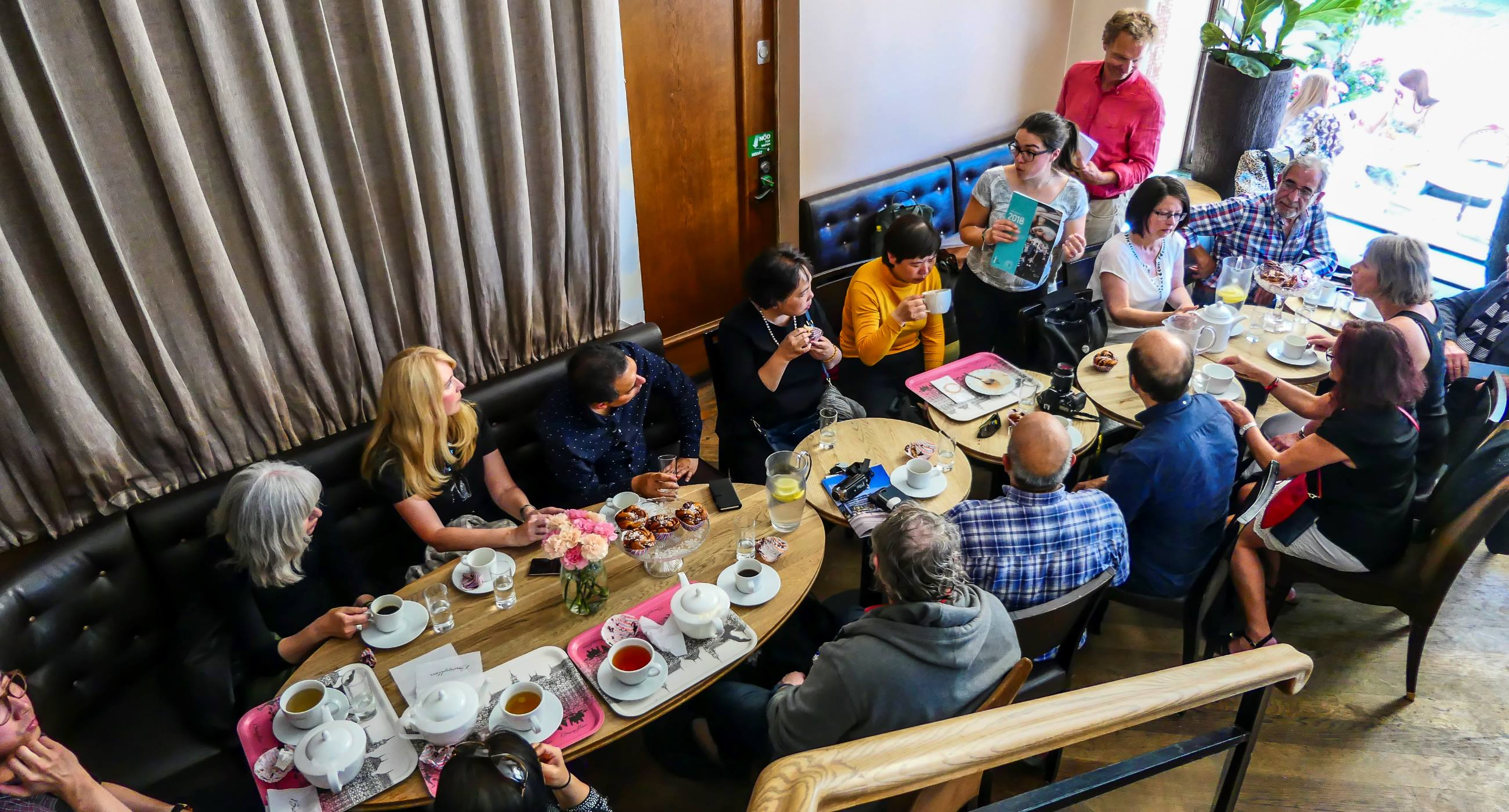 Group-of-adults-enjoying-each-others-company-drinking-coffee-during-Fika-time