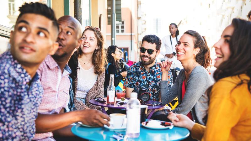 Group-of-friends-at-cafe-enjoying-Fika