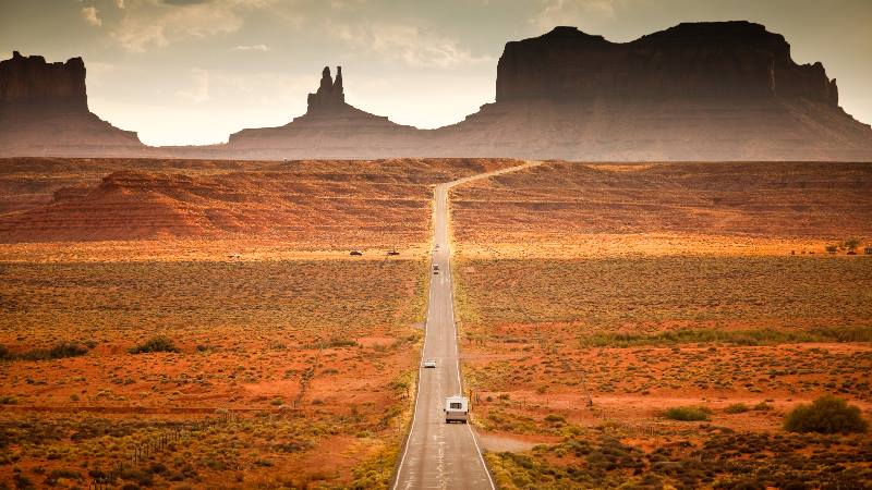 Motorhome camper on road trip USA in the southwest red rock landscape near Monument Valley arizona