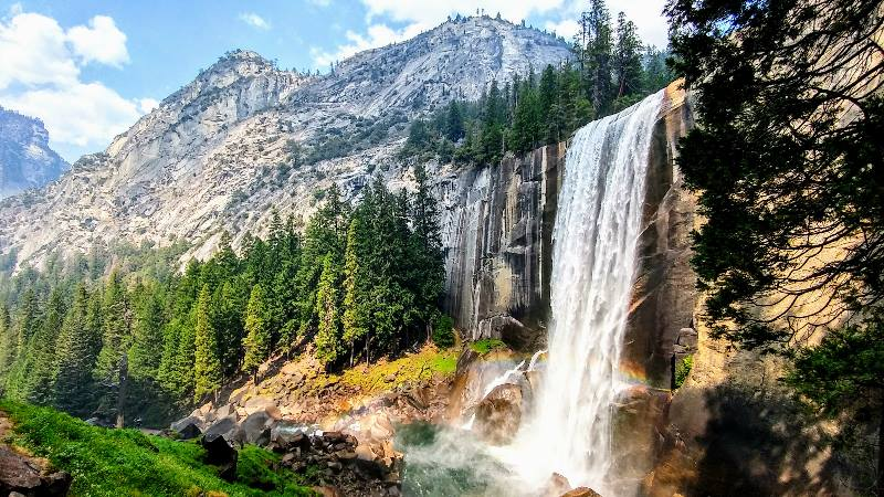 Beautiful waterfalls of Vernal Falls with mountains in the background on America Road Trip USA