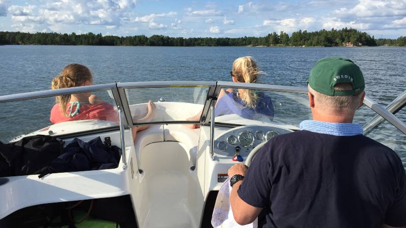 Sitting-in-front-of-boat-on-the-waters-around-the-Venice-of-the-North-Stockholm