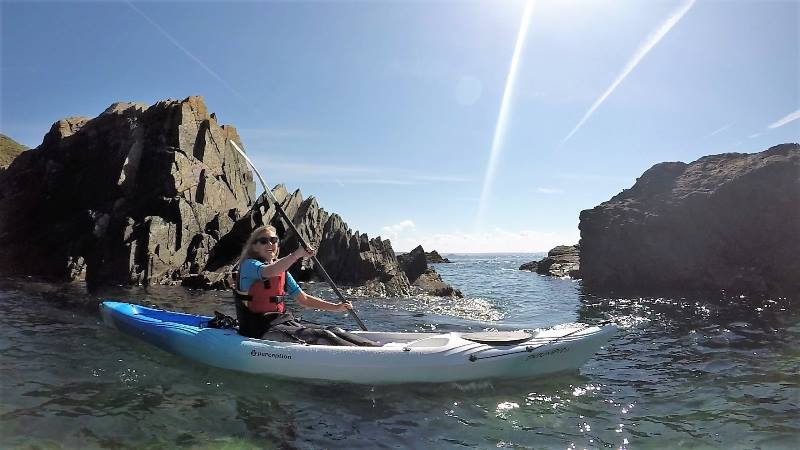 Lady-kayaking-in-the-sea-off-the-coast-of-Wales