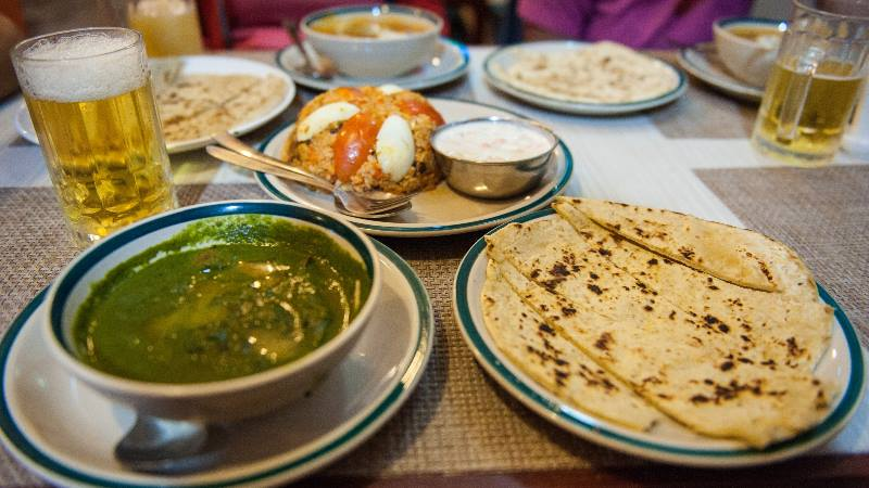 Kathmandu-food-and-culture-a-plate-of-Nepali-food-with-drinks