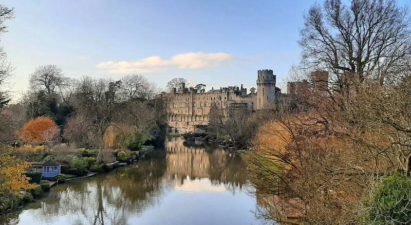 View-of-Warwick-castle-in-England-with-reflection-on-the-water
