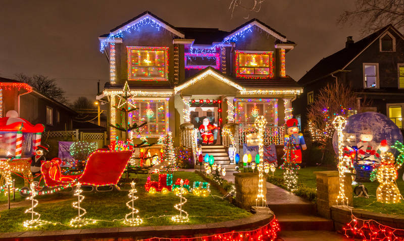 traditional-ways-celebrate-christmas in america-driving-neighborhood-christmas lights