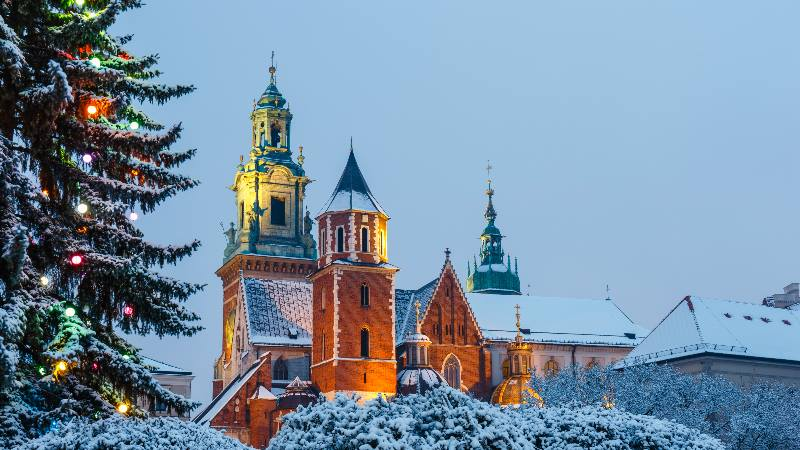 View-of-Christmas-lights-snow-on-the-cathedral-in-Krakow-Poland-for-Winter