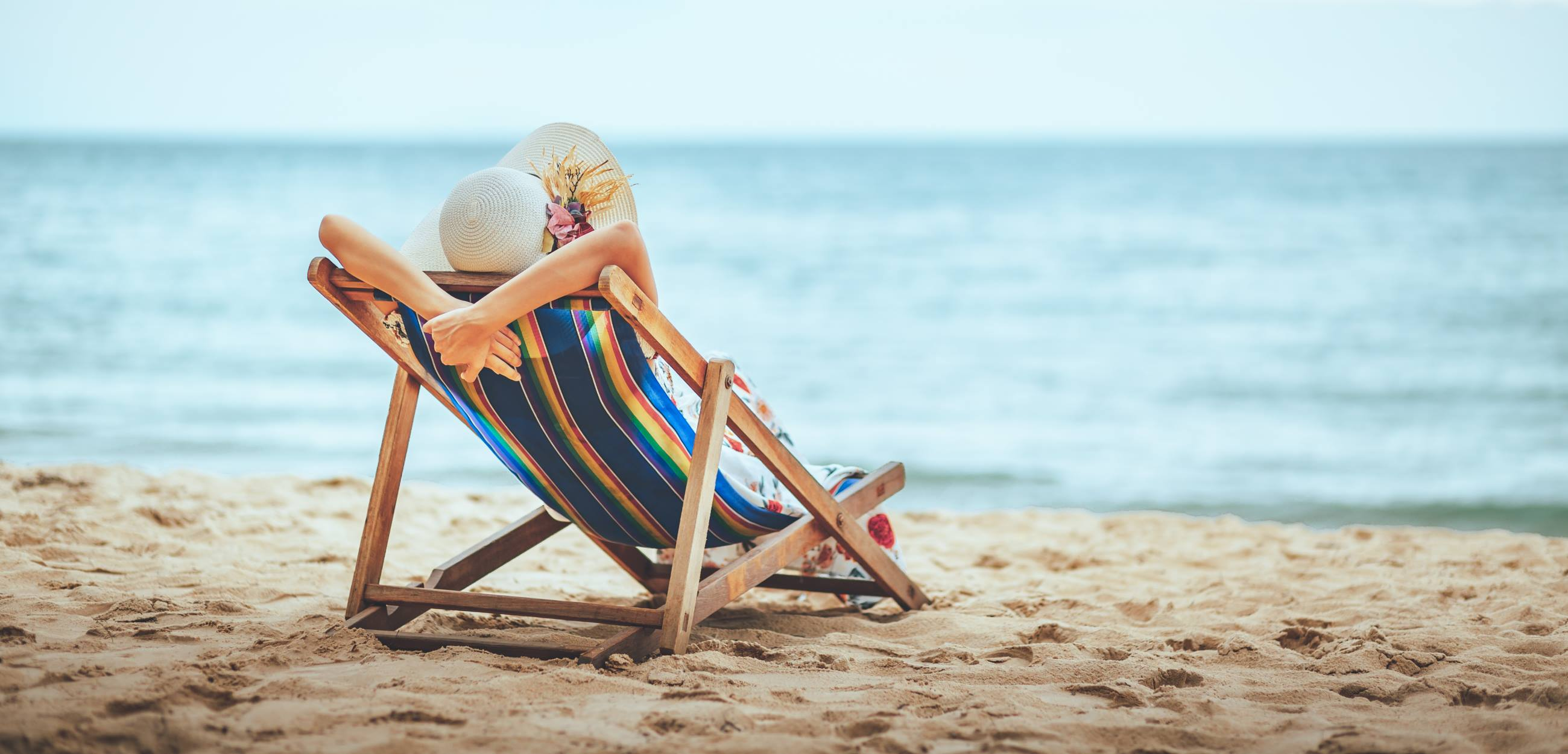 5-Safest-Places-for-Solo-Travel-lady-relaxing-on-a-chair-on-the-beach
