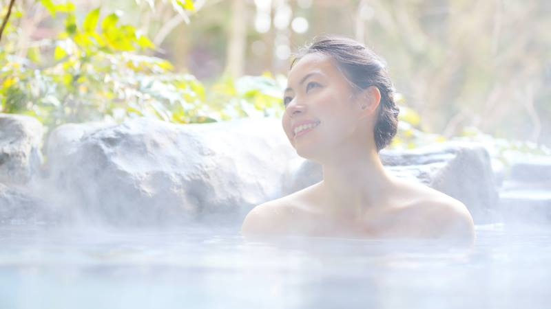 Japanese-lady-relaxing-in-a-hot-spring-first-trip-to-japan