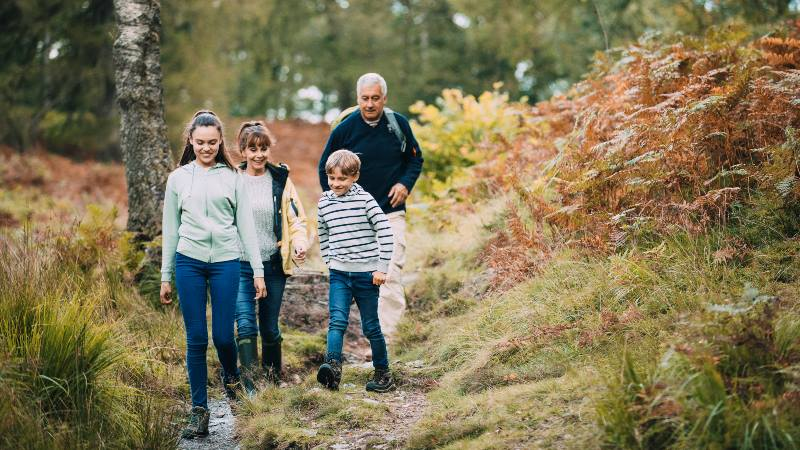 Two-children-are-hiking-with-their-grandparents-in-the-woodland-of-the-Lake-District