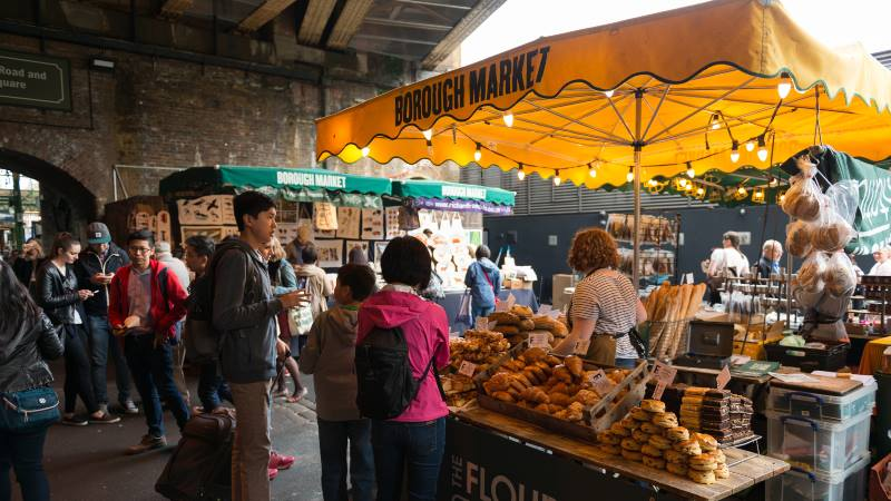 Travelers-and-locals-shopping-for-fresh-food-early-in-the-day-at-the-famous-Borough-Market