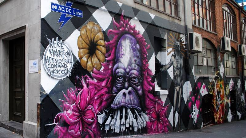 view-of-ac/dc-street-with-street-art-of-monkey-with-piano-keys-coming-out-it's-mouth-unique-experiences-in-melbourne
