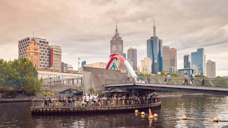 ponyfish-island-cafe-and-south-bank-pedestrian-bridge-with-people-in-the-evening