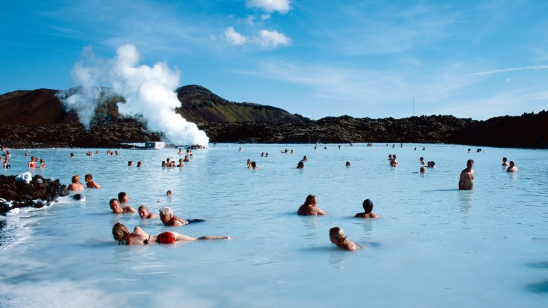 View of people relaxing in the hot waters of the Blue Lagoon near Reykjavik