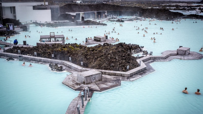 View of the Blue Lagoon with people relaxing in the warm waters