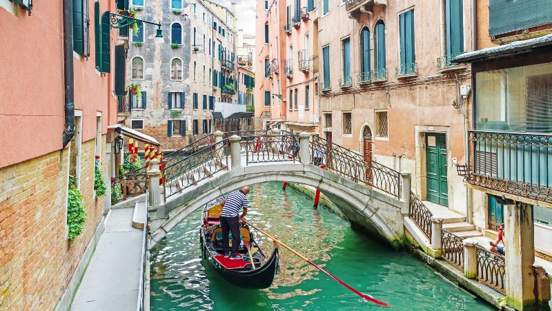 Gondola moving along a canal in Venice